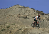 Daryl Newcomb rides descends on Joe's Ridge at the Bookcliffs near Fruita, Colo., for the 12th...
