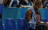 Moments after fouling out of the game in the fourth quarter, American basketball player Tim Duncan...