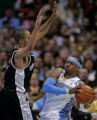 San Antonio's Tony Parker, left, guards Denver's Allen Ivers tightly in the fourth quarter of play...