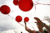 MJM125  Lisl Auman (cq), right,  sorts through balloons during a Mother's Day demonstration on...