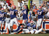 October 16, 2004-- Gainesville, Fla. Gator defensive players Steven Harris, #93, Marcus Thomas,...