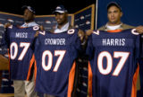 DLM0309  Denver Broncos' 2007 draft picks Jarvis Moss (cq), from left, Timothy Crowder (cq) and...