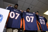 DLM0341  Denver Broncos' 2007 draft picks Jarvis Moss (cq), from left, Timothy Crowder (cq) and...