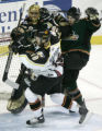 Steve Haddon, right, checks Bobby Gates, in front of goalie, #35, in the 1st period of the...