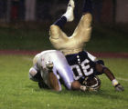 (Denver, Colo., August 27, 2004) Mullen's #30-Brandon Taylor tumbles head over feet to chase after...