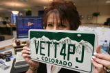 P.J. Taylor holds her own personalized plate. She is the Administrator of the DMV here on Thursday...