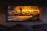 DLM1572  A man searches the South Platte River under a bridge just south of 20th Street for a...