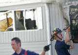 BG0216 A Federal Heights firefighter checks for hot spots with a meter in a mobile home while...