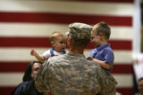 Sgt. Scott Rayl, cq, of Colorado Springs carries his two children Jacob Rayl, 7 months and Collin...