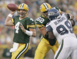 WIMR101 - Green Bay Packers' quarterback Brett Favre (4) looks for a receiver as offensive lineman...
