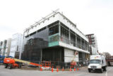 The Museum of Contemporary Art is getting its exterior black glass installed at 15th and Delgany...