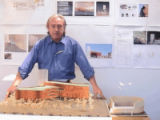 *still from video DVD*  Architect Steven Holl is shown in his studio describing his design for a...