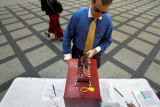 DLM0366  Mark Aroneck, 36, of Denver cast his ballot for the city elections at  the early voting...