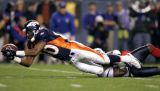 (DENVER, Co., SHOT 8/27/2004) The Denver Broncos' Rod Smith (#80) stretches for extra yardage...