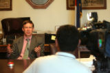 Mayor Hickenlooper answers questions during a TV interview by Cesar Pacheco (cq), right, of...