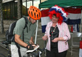 Deborah Gokey (cq), right, collects a ballot from a Zeth Lietzau (cq), at the corner of Court and...