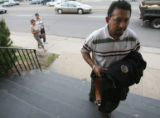 On May 1st., 2007, 42 year-old Jorge Mora (cq) walks up the steps of the Funeraria Latina funeral...