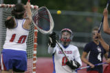 0413 Cherry Creek goalie Annette Greenberg makes a save in the first half against Kent Denver as...