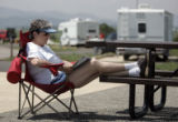 Rosalie Feldman (cq) from Loveland, CO relaxes with a good magazine as she camps at Chatfield...
