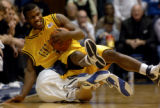NCSD102 - Kent State's Chris Singletary, top, trips over Duke's Jon Scheyer in the first of half...