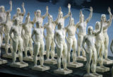 (ATHENS, GREECE, AUGUST 13, 2004)  Statues of Greek men played by performers in costume parade...