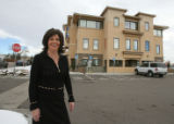 Insurance agent Michelle De Carlo (cq) stands in front of her new office building on Tuesday...