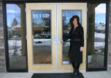 Insurance agent Michelle De Carlo (cq) stands in front of her new office building on Tuesday,...