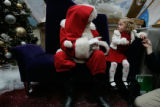 PLEASE REFER READERS TO A WEB SLIDESHOW ABOUT SIGNING SANTA. Meadow Rodine, 3 of Castle Rock was...