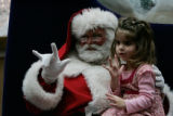 Kyra Dinkins, 3 with Castle View HS Preschool II tries to sign 'I love you' along with Santa but...