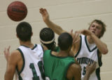 ThunderRidge's Jesse Stender, right, tries to save the ball to teammate Scott Day, far left, being...
