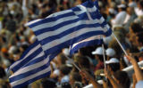 (Athens, Greece  on Friday, Aug. 13, 2004) - The flag of Greece waved by spectators at the Opening...