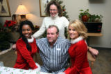 left, Kenya Johnson poses with husband and wife, kneeling, Howard Cole, standing, Tammy Jones, and...