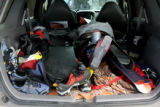 The back of a SUV is used as a sports locker Tuesday Dec. 27, 2006 as a group of friends  hope to...