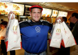 PRN2 - US Olympic gold medalist wrestler, Rulon Gardner stops by one of McDonald's three Olympic...