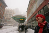 Snow storm in Denver December 20, 2006.  Cheryl Bicknell (cq) of Denver, waits for the lightrail...