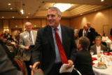 Governor-elect Bill Ritter smiles as he exits a luncheon in Denver Wednesday Dec. 6, 2006, after...