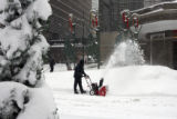 John Shober (cq) clears snow from the driveway at the Adam's Mark Hotel,  at 1550 Court...