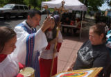(Denver, Colo., May 16, 2004) Priest Franco I Plascencia C.R. center left, blesses a picture of...