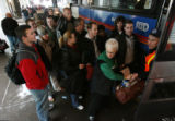 MJM1799  Stranded travelers with hotel reservations board one of ten RTD buses that were...