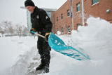 (DLM0544) -   Denver Police Sgt. Greg Jones shovels the front walk as he digs the District Three...