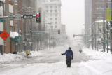 Bill Covode (cq) hitchhikes down 15th St. in downtown Denver, on Thursday, December 21, 2006 as he...