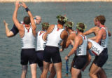 (ATHENS, GREECE-AUGUST 22, 2004)  United States' Men's 8 Coxswain, Pete Cipollone, top left, is...
