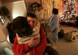 Christopher Lee Redlin (CQ), right, hugs his sister Ashley Redlin (CQ), left, after being returned...