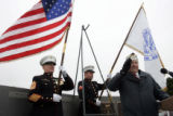 Pearl Harbor survivor Bill Browning (cq) (r), 84, salutes the American Flag during the 65th Annual...