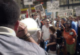 NEW YORK CITY, NY - AUGUST 29, 2004 -- Anti-George W. Bush protesters clash with two of the...
