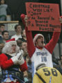 Denver Nugget fans cheer on their team and newly acquired guard Allen Iverson as he suited up for...
