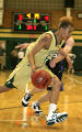 (DLM3367) -   Aurora Central senior Sean Cunningham drives past Cherry Creek senior Karl Heimbrock...