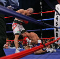 NY150 - ** FILE **  Miguel Cotto, of  Puerto Rico, overlooks Carlos Quintana, also of Puerto...