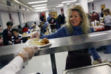 MJM152  Volunteer, Suzanne Rothman (cq) gets a meal to serve Friday at the Denver Rescue Mission...