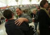 MJM439  Kevin Gerrasch (cq) greets his son, Zach Gerrasch (cq), 13, as he arrives Friday afternoon...